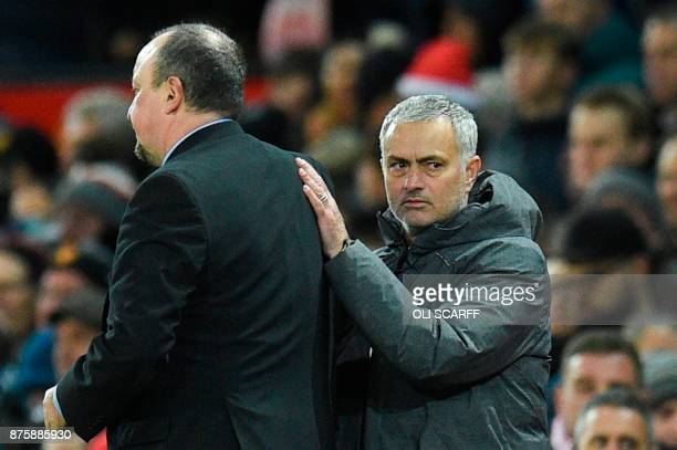 Manchester United's Portuguese manager Jose Mourinho shakes hands with Newcastle United's Spanish manager Rafael Benitez at the end of the English...