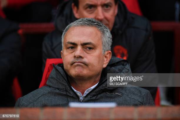 Manchester United's Portuguese manager Jose Mourinho sits in the dugout before the UEFA Europa League quarterfinal second leg football match between...