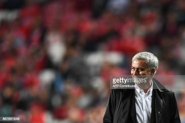 Manchester United's Portuguese manager Jose Mourinho smiles during the UEFA Champions League group A football match SL Benfica vs Manchester United...