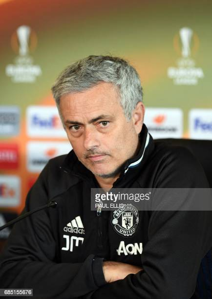 Manchester United's Portuguese manager Jose Mourinho speaks to members of the media at a press conference part of a media open day at the club's...