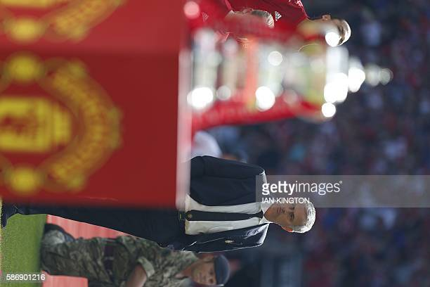 Manchester United's Portuguese manager Jose Mourinho stands by as the team's are introduced for the FA Community Shield football match between...