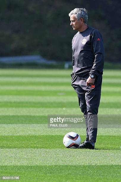 Manchester United's Portuguese manager Jose Mourinho takes a team training session at their Carrington Training Centre in Manchester, north west...