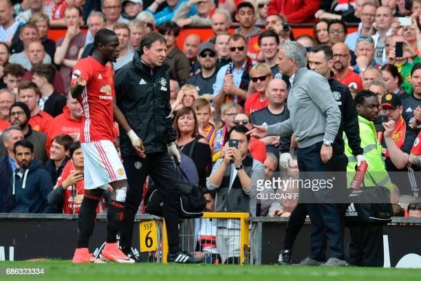 Manchester United's Portuguese manager Jose Mourinho talks with Manchester United's Ivorian defender Eric Bailly on the touchline during the English...