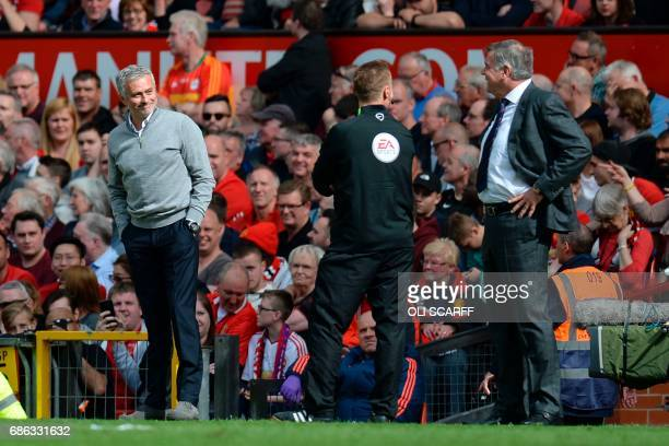 Manchester United's Portuguese manager Jose Mourinho talks with Crystal Palace's English manager Sam Allardyce on the touchline during the English...