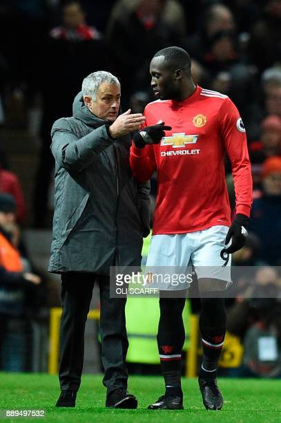 Manchester United's Portuguese manager Jose Mourinho talks with Manchester United's Belgian striker Romelu Lukaku during halftimes during the English...