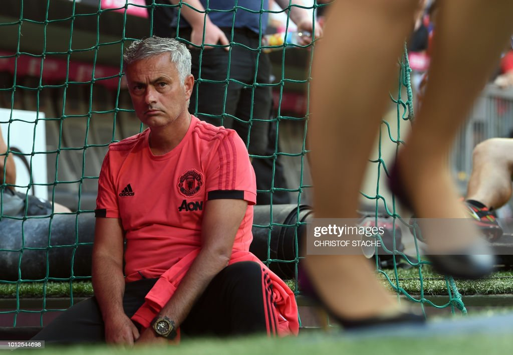 Manchester United's Portuguese manager Jose Mourinho waits for the warm up prior to the pre-season friendly football match between FC Bayern Munich and Manchester United at the Allianz Arena in Munich, southern Germany, on August 5, 2018.
