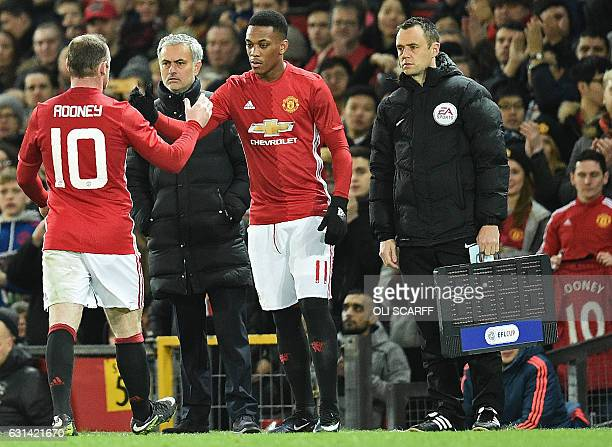 Manchester United's Portuguese manager Jose Mourinho watches as Manchester United's French striker Anthony Martial is substitued onto the pitch for...