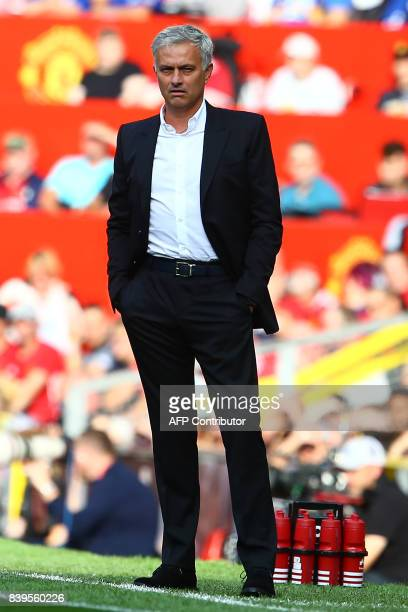 Manchester United's Portuguese manager Jose Mourinho watches from the touchline during the English Premier League football match between Manchester...