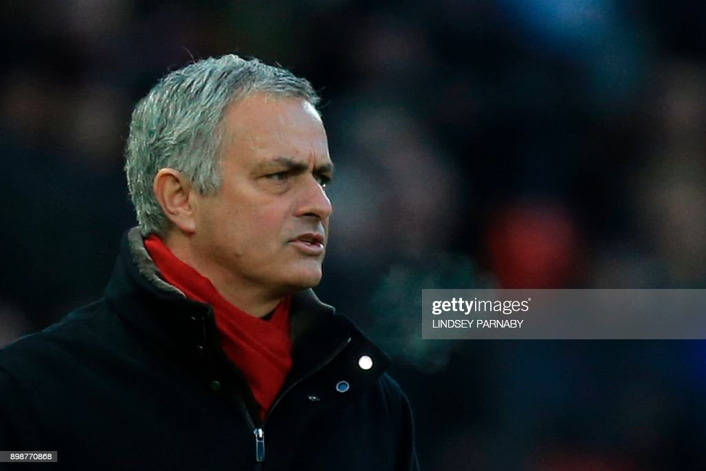 Manchester United's Portuguese manager Jose Mourinho watches from the touchline during the English Premier League football match between Manchester United and Burnley at Old Trafford in Manchester, north west England, on December 26, 2017. / AFP PHOTO / Lindsey PARNABY / RESTRICTED TO EDITORIAL USE. No use with unauthorized audio, video, data, fixture lists, club/league logos or 'live' services. Online in-match use limited to 75 images, no video emulation. No use in betting, games or single club/league/player publications. /