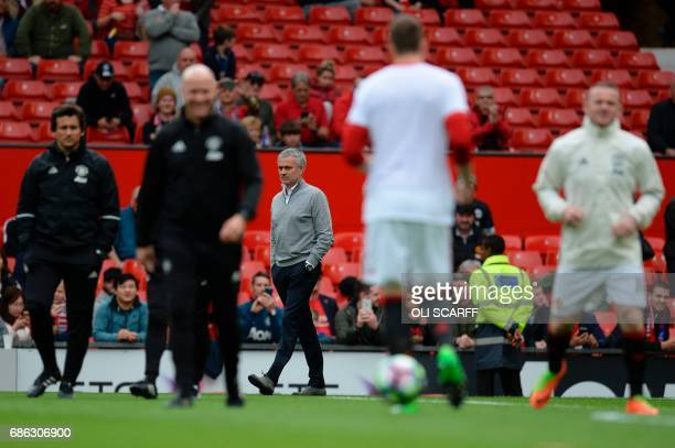 Manchester United's Portuguese manager Jose Mourinho watches his team warm up ahead of the English Premier League football match between Manchester...