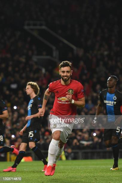 Manchester United's Portuguese midfielder Bruno Fernandes celebrates scoring his team's first goal during the UEFA Europa League round of 32 second...