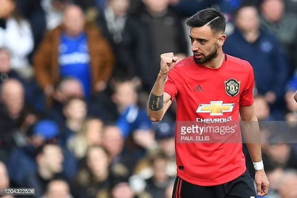 Manchester United's Portuguese midfielder Bruno Fernandes celebrates after scoring the equalising goal during the English Premier League football...