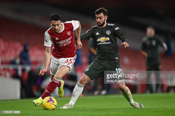 Manchester United's Portuguese midfielder Bruno Fernandes challenges Arsenal's Brazilian striker Gabriel Martinelli during the English Premier League...