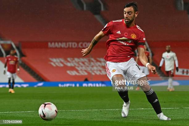 Manchester United's Portuguese midfielder Bruno Fernandes controls the ball during the English Premier League football match between Manchester...