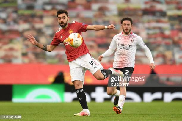 Manchester United's Portuguese midfielder Bruno Fernandes controls the ball in front of AC Milan's Italian defender Davide Calabria during the UEFA...