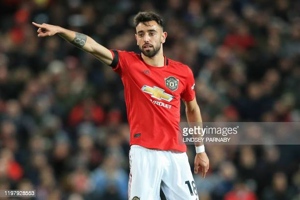 Manchester United's Portuguese midfielder Bruno Fernandes gestures during the English Premier League football match between Manchester United and...