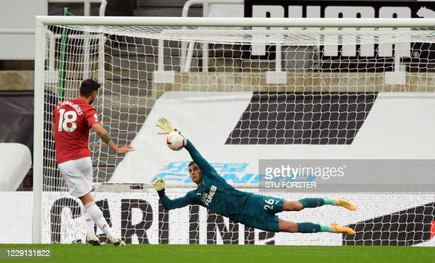 Manchester United's Portuguese midfielder Bruno Fernandes has a penalty saved by Newcastle United's English goalkeeper Karl Darlow during the English...