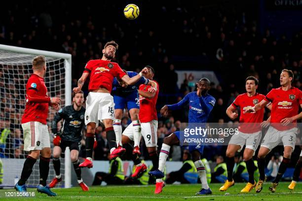 Manchester United's Portuguese midfielder Bruno Fernandes jumps to win a header during the English Premier League football match between Chelsea and...