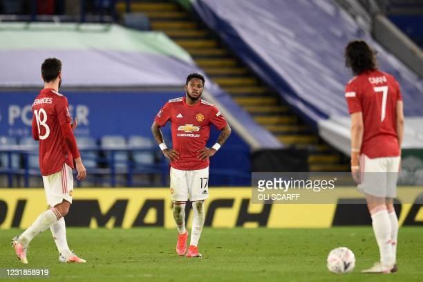 Manchester United's Portuguese midfielder Bruno Fernandes , Manchester United's Brazilian midfielder Fred and Manchester United's Uruguayan striker...