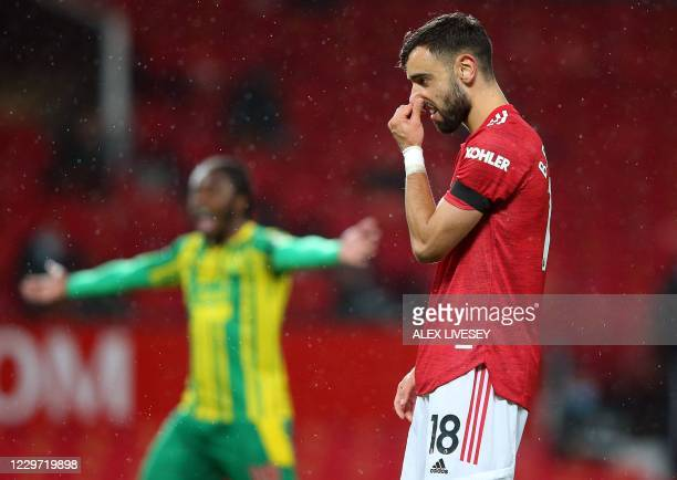 Manchester United's Portuguese midfielder Bruno Fernandes reacts after missing a penalty during the English Premier League football match between...