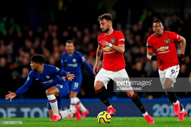 Manchester United's Portuguese midfielder Bruno Fernandes runs with the ball during the English Premier League football match between Chelsea and...