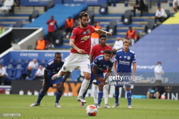Manchester United's Portuguese midfielder Bruno Fernandes scores the opening goal from the penalty spot during the English Premier League football...