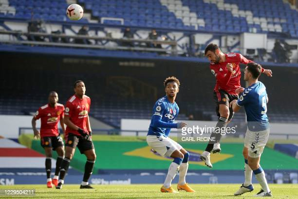 Manchester United's Portuguese midfielder Bruno Fernandes scores the equalising goal during the English Premier League football match between Everton...
