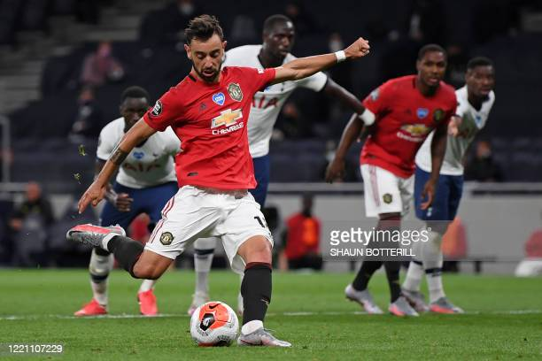 Manchester United's Portuguese midfielder Bruno Fernandes scores their first goal from the penalty spot during the English Premier League football...
