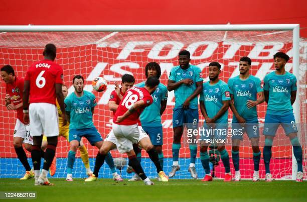 Manchester United's Portuguese midfielder Bruno Fernandes shoots a free kick and scores during the English Premier League football match between...