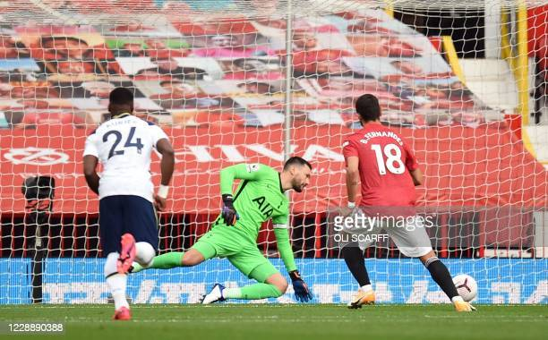 Manchester United's Portuguese midfielder Bruno Fernandes shoots from the penalty spot to score his team's opening goal past Tottenham Hotspur's...