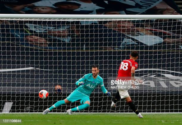 Manchester United's Portuguese midfielder Bruno Fernandes shoots to score from the penalty spot past Tottenham Hotspur's French goalkeeper Hugo...