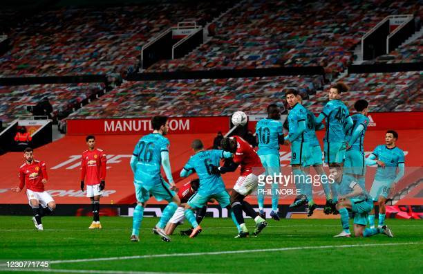 Manchester United's Portuguese midfielder Bruno Fernandes shoots to score from a free kick for their third goal during the English FA Cup fourth...