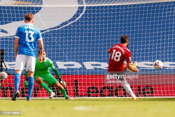 Manchester United's Portuguese midfielder Bruno Fernandes takes a penalty and scores his team's third goal during the English Premier League football...