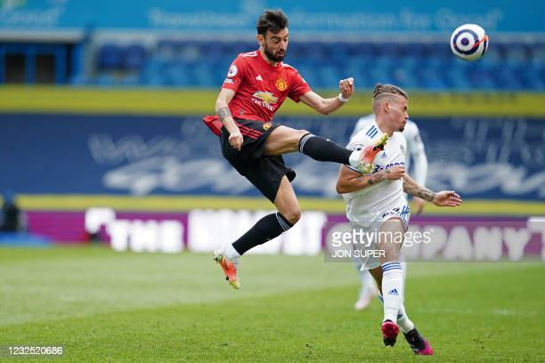 Manchester United's Portuguese midfielder Bruno Fernandes vies with Leeds United's English midfielder Kalvin Phillips during the English Premier...