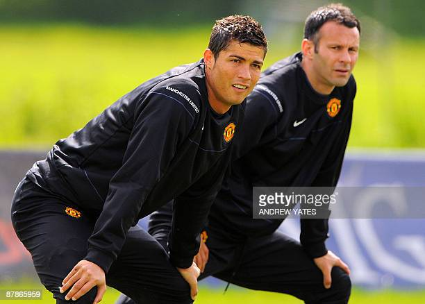 Manchester United's Portuguese midfielder Cristiano Ronaldo and Manchester United's Welsh midfielder Ryan Giggs look on during a training session at...
