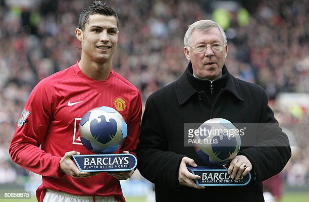 Manchester United's Portuguese midfielder Cristiano Ronaldo and manager Sir Alex Ferguson receive their player and manager of the month awards before...