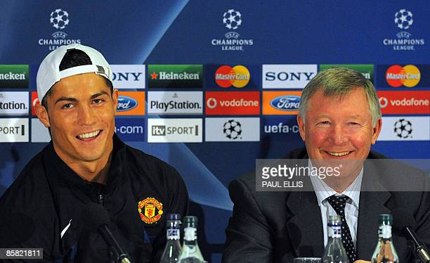 Manchester United's Portuguese midfielder Cristiano Ronaldo and manager Sir Alex Ferguson attend a press conference in Manchester north west England...