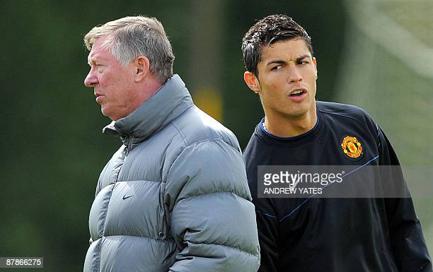 Manchester United's Portuguese midfielder Cristiano Ronaldo is pictured with Manchester United manager Alex Ferguson during a training session at the...