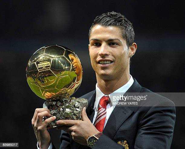 Manchester United's Portuguese midfielder Cristiano Ronaldo poses with the Ballon D'or trophy before their UEFA Champions league group E football...