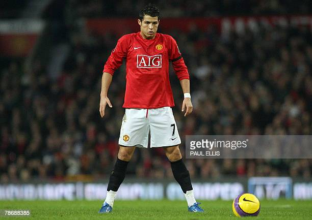 Manchester United's Portuguese midfielder Cristiano Ronaldo prepares to take a free kick against Birmingham City during their English Premiership...