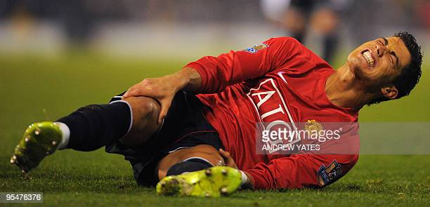 Manchester United's Portuguese midfielder Cristiano Ronaldo reacts after being hurt in a tackle during the English Premier league football match...