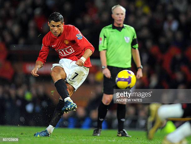 Manchester United's Portuguese midfielder Cristiano Ronaldo scores the fifth goal against Stoke City during their English Premiership football match...