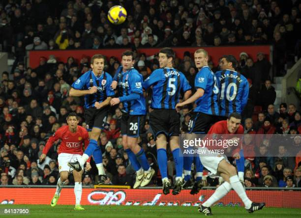 Manchester United's Portuguese midfielder Cristiano Ronaldo shoots a free kick over the Middlesbrough defensive wall during the English Premiership...