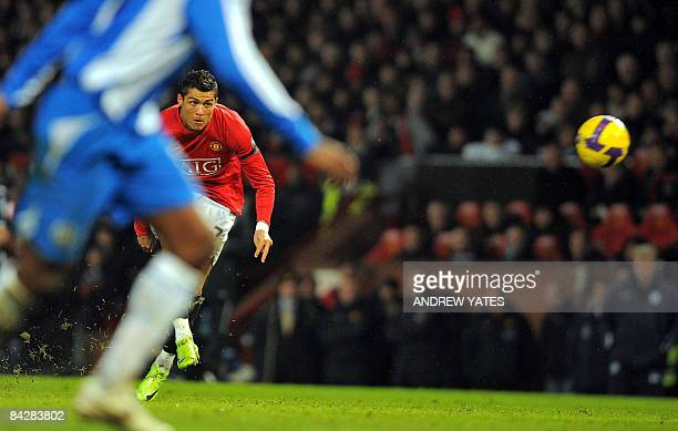 Manchester United's Portuguese midfielder Cristiano Ronaldo takes a free kick during the English Premiership football match against Wigan at Old...
