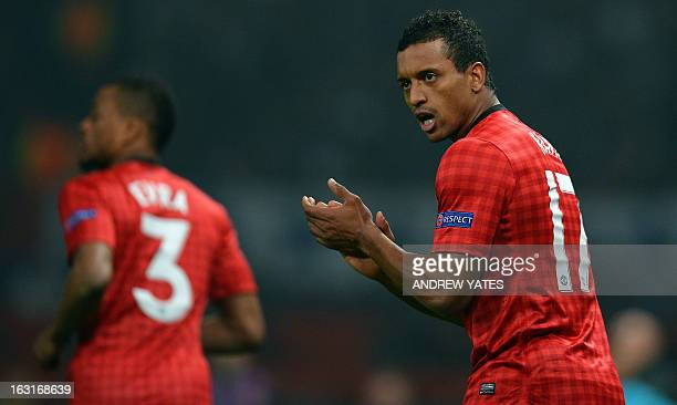 Manchester United's Portuguese midfielder Nani applauds after their goal during the UEFA Champions League round of 16 second leg football match...