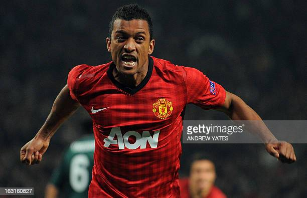 Manchester United's Portuguese midfielder Nani celebrates after Real Madrid's Spanish defender Sergio Ramos scored an own goal during the UEFA...