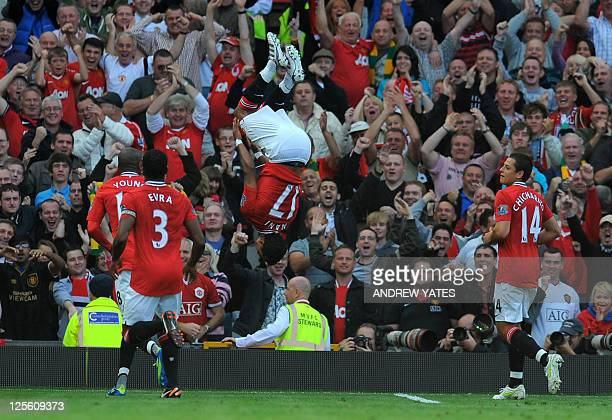 Manchester United's Portuguese midfielder Nani celebrates scoring their third goal during the English Premier League football match between...