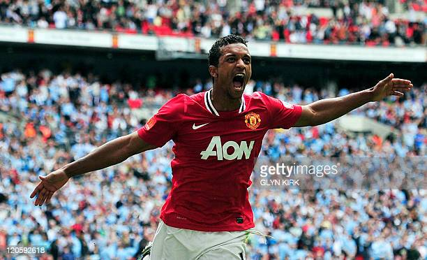 Manchester United's Portuguese midfielder Nani celebrates scoring the third and winning goal during the FA Community Shield football match against...