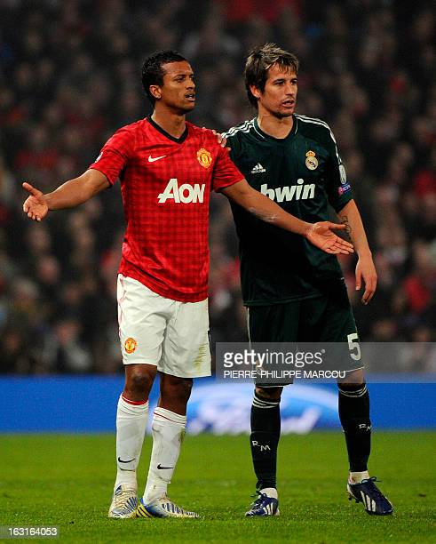 Manchester United's Portuguese midfielder Nani reacts to being sent off next to Real Madrid's Portuguese defender Fabio Coentrao during the UEFA...