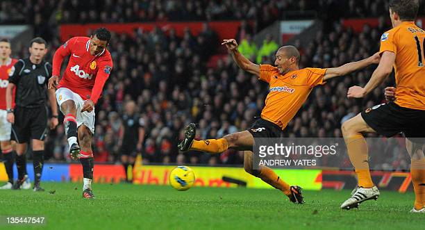 Manchester United's Portuguese midfielder Nani shoots past Wolverhampton Wanderers' English midfielder Carl Henry and Scottish defender Christophe...